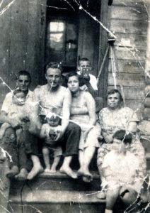 Efim Pisarenko, his brother Misha Pisarenko and their neighbors (Gomel 1938)